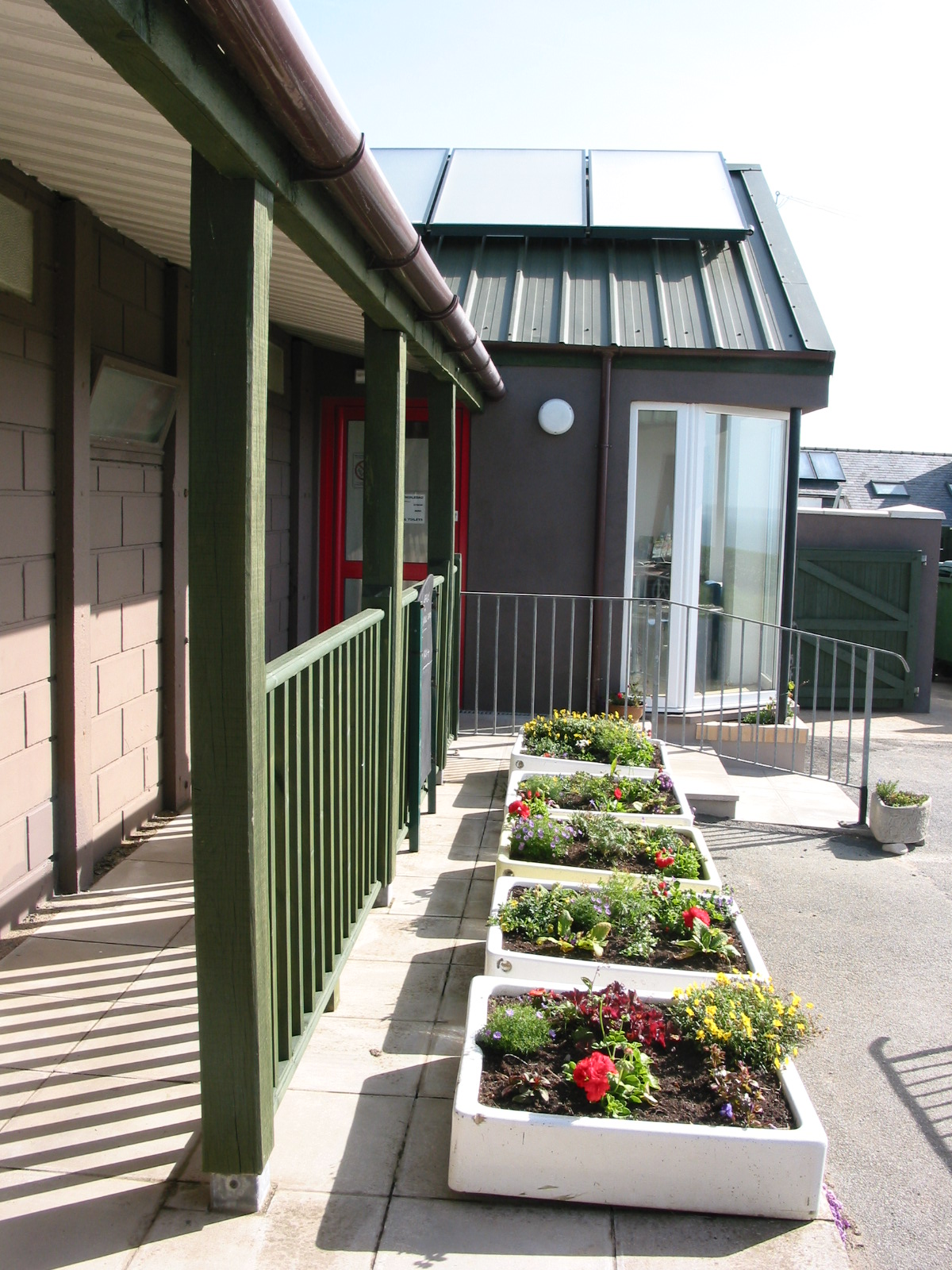 Solar panels and flower pots from reused shower basins